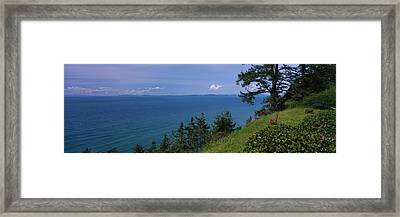 Old Red Chair Near The Sea, Strait Framed Print by Panoramic Images