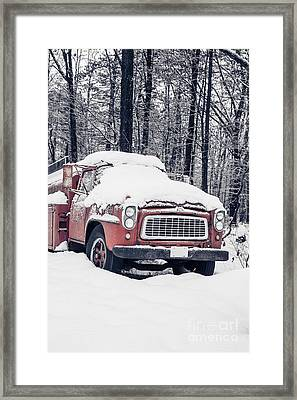 Old Red Fire Truck Covered With Snow Framed Print