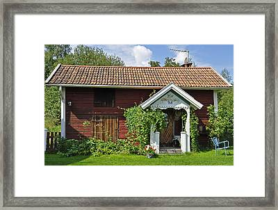 Old Red Wooden Hut Framed Print by Conny Sjostrom