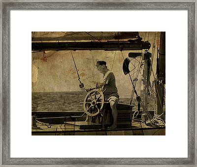old sailor A vintage processed photo of a sailor sitted behind the rudder in Mediterranean sailing Framed Print