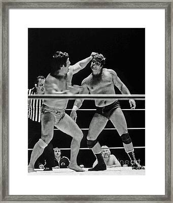 Framed Print featuring the photograph Old School Wrestlers Dean Ho And Don Muraco Battling It Out In The Middle Of The Ring by Jim Fitzpatrick