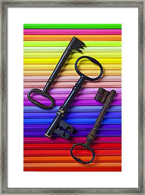 Old Skeleton Keys On Rows Of Colored Pencils Framed Print