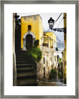 Old Street In Positano Framed Print by George Oze