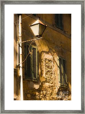 Old Street Lamp And Shuttered Windows In Montalcino Framed Print