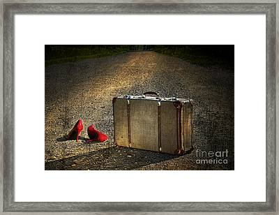 Old Suitcase With Red Shoes Left On Road Framed Print by Sandra Cunningham