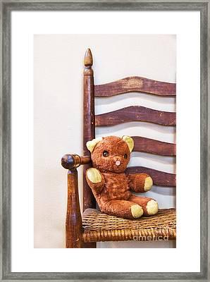 Old Teddy Bear Sitting In Chair Framed Print by Birgit Tyrrell