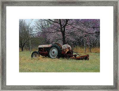 Old Tractor And Redbuds Framed Print