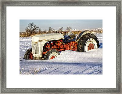Old Tractor In The Snow Framed Print