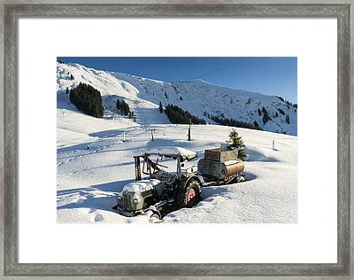 Old Tractor In Winter With Lots Of Snow Waiting For Spring Framed Print
