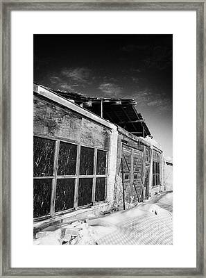 old traditional brick and wood building in disrepair Forget Framed Print by Joe Fox