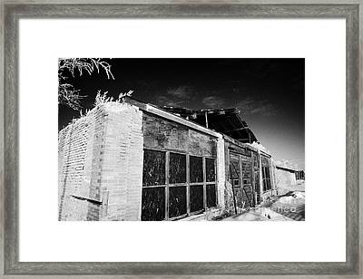 old traditional brick and wood building in disrepair Forget Saskatchewan Canada Framed Print by Joe Fox