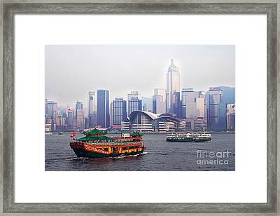 Old Traditional Chinese Junk In Front Of Hong Kong Skyline Framed Print by Lars Ruecker