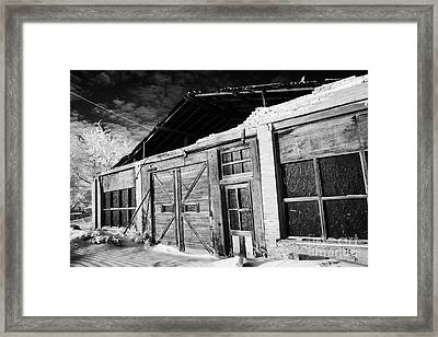 old tradtional brick and wood building in disrepair Forget Saskatchewan Canada Framed Print by Joe Fox