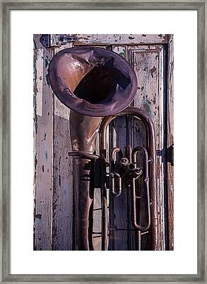 Old Tuba On Worn Door Framed Print