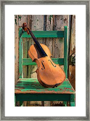 Old Violin On Green Chair Framed Print by Garry Gay