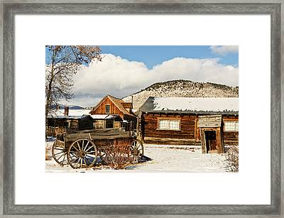 Old Wagon And Ghost Town Buildings Framed Print by Sue Smith