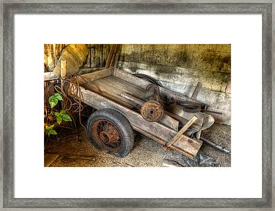 Old Wagon In The Barn Framed Print