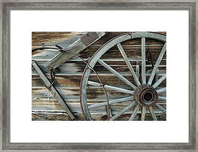 Old Wagon Wheel In Nevada City Montana Framed Print