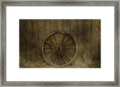 Old Wagon Wheel On Barn Wall Framed Print by Dan Sproul