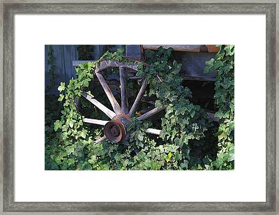 Old Wagon Wheel On The Farm Framed Print by Dan Sproul