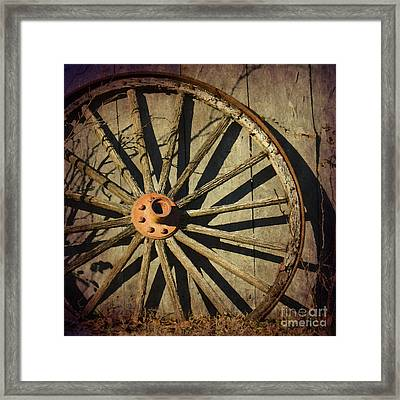 Old West Wagon Wheel Framed Print by Betty LaRue