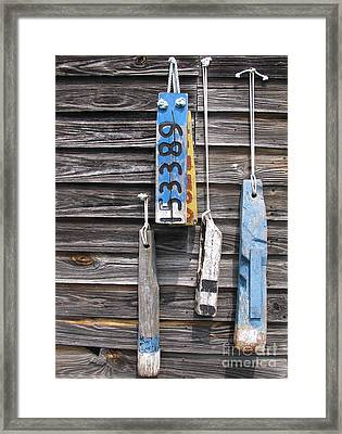 Old Wooden Buoys Framed Print by Colleen Kammerer