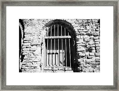 Old Wooden Framed Window With Weathered Steel Bars In Red Brick Building With Plaster Removed Krakow Framed Print by Joe Fox