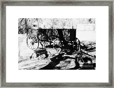 old wooden horse drawn farm wagon and sleigh bengough Saskatchewan Canada Framed Print by Joe Fox