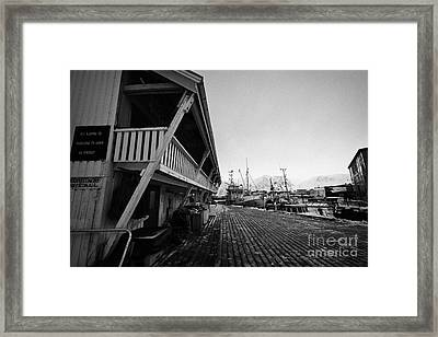 old wooden warehouses and buildings for drying fish Honningsvag harbour finnmark norway europe Framed Print by Joe Fox
