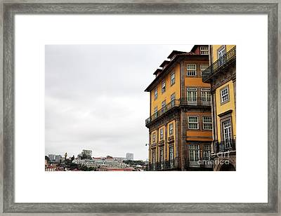 Old World Buildings In  Porto Framed Print by John Rizzuto