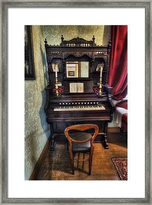 Olde Piano Framed Print