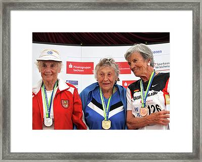 Older Female Athletes On Medals Rostrum Framed Print