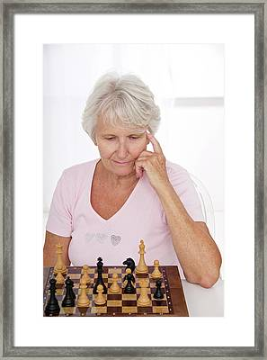 Older Lady Playing Chess Framed Print by Lea Paterson