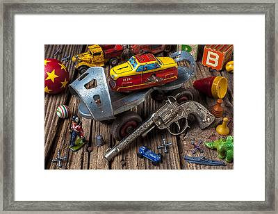Older Roller Skate And Toys Framed Print