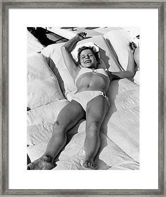 Olga Korbut Lying Down In The Sun Framed Print by Duane Michals