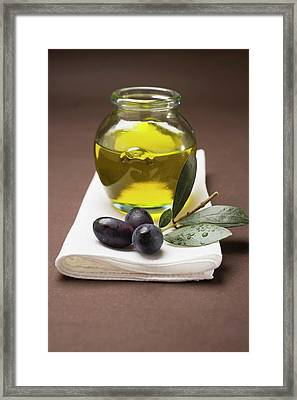 Olive Sprig With Black Olives, Jar Of Olive Oil Behind Framed Print