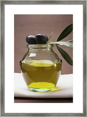 Olive Sprig With Black Olives On Jar Of Olive Oil Framed Print
