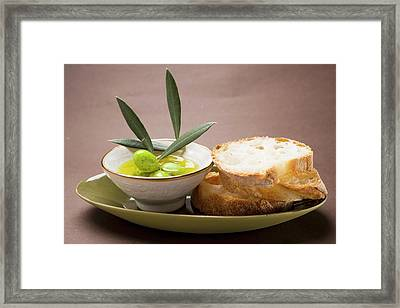 Olive Sprig With Green Olives In Bowl Of Olive Oil, White Bread Framed Print