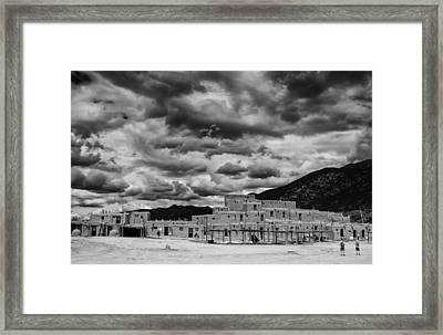 Ominous Clouds Over Taos Pueblo Framed Print