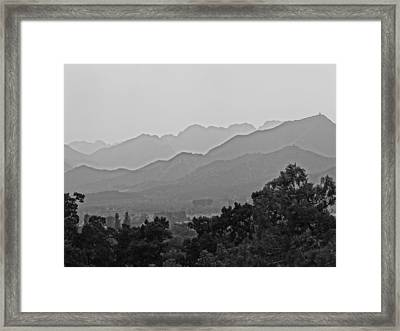 On Distant Heights Framed Print by Olivia Blessing