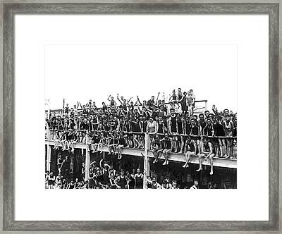 On The Coney Island Boardwalk Framed Print by Underwood Archives