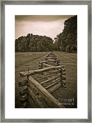 On The Fence Framed Print by Charles Dobbs