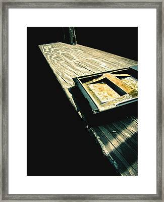 On The Ledge Framed Print by Jessica Brawley