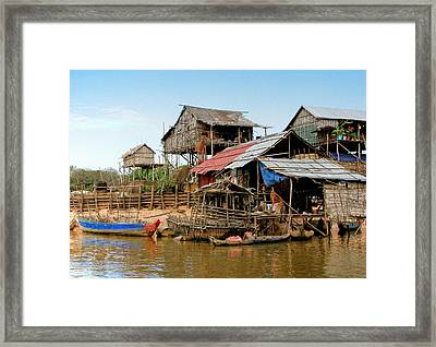 On The Shores Of Tonle Sap Framed Print by Douglas J Fisher