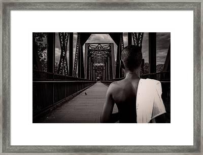 One Boy One Pigeon One Bridge Framed Print by Bob Orsillo