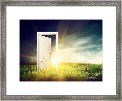 Open Door On The Green Field Framed Print by Michal Bednarek