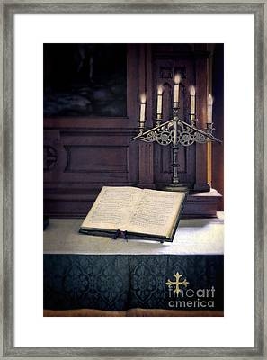 Open Hymnal And Candles On Altar Framed Print by Jill Battaglia