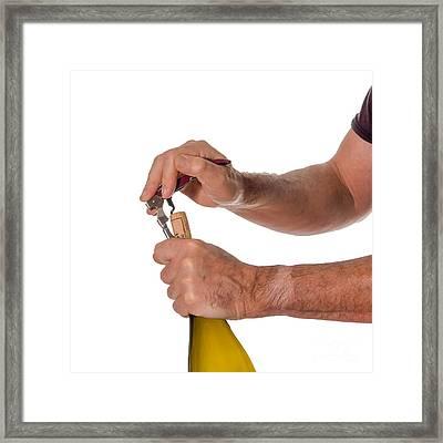 Opening A Bottle Of Wine Framed Print