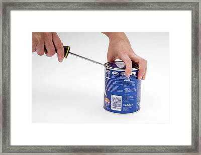 Opening A Can With A Lever Framed Print