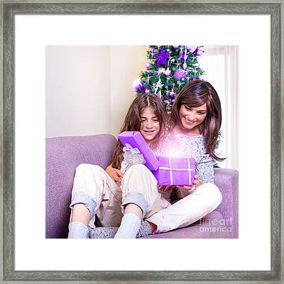 Opening Christmas Present Framed Print by Anna Om